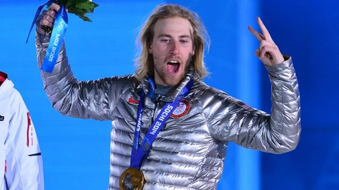 Feb 8, 2014; Sochi, RUSSIA; Sage Kotsenburg (USA), right, and Staale Sandbech (NOR) react after receiving their medals during the medal ceremony for the snowboard slopestyle in the Sochi 2014 Olympic Winter Games at the Medals Plaza. Mandatory Credit: Scott Rovak-USA TODAY Sports