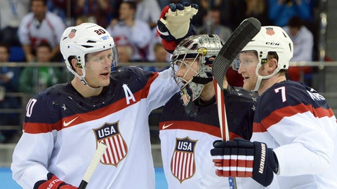 Feb 13, 2014; Sochi, RUSSIA; USA goalie Jonathan Quick (32) is congratulated by teammates defenseman Paul Martin (7) and defenseman Ryan Suter (20) after a men's ice hockey preliminary round game against Slovakia during the Sochi 2014 Olympic Winter Games at Shayba Arena. Mandatory Credit: Jayne Kamin-Oncea-USA TODAY Sports