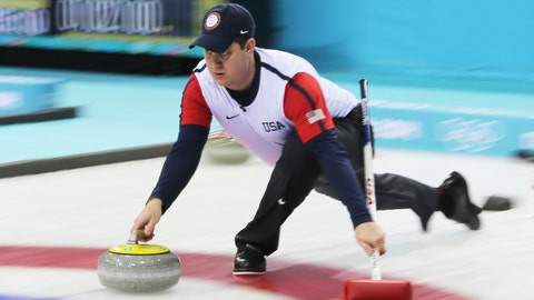 Feb 13, 2014; Sochi, RUSSIA; John Shuster (USA) delivers a stone in the men's curling round robin session 6 during the Sochi 2014 Olympic Winter Games at Ice Cube Curling Center. Mandatory Credit: James Lang-USA TODAY Sports