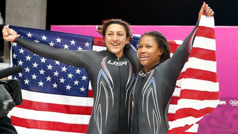 Feb 19, 2014; Krasnaya Polyana, RUSSIA; Team USA 1 piloted by Elana Meyers and Lauryn Williams (right) celebrate the American flag after winning the silver medal in the women's bobsleigh during the Sochi 2014 Olympic Winter Games at Sanki Sliding Center. Mandatory Credit: Kevin Jairaj-USA TODAY Sports
