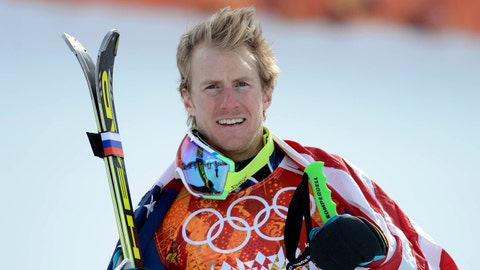 Feb 19, 2014; Krasnaya Polyana, RUSSIA; Ted Ligety (USA) celebrates with the American flag after winning the gold medal following the men's giant slalom during the Sochi 2014 Olympic Winter Games at Rosa Khutor Alpine Center. Mandatory Credit: Jack Gruber-USA TODAY Sports