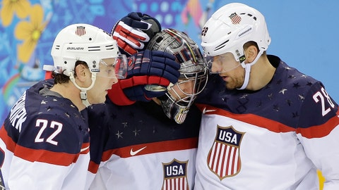 USA defenseman Kevin Shattenkirk, goaltender Jonathan Quick and forward Blake Wheeler celebrate their 5-2 win over the Czech Republic after the men's quarterfinal hockey game in Shayba Arena at the 2014 Winter Olympics, Wednesday, Feb. 19, 2014, in Sochi, Russia. (AP Photo/David J. Phillip )