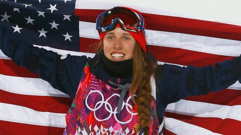 Maddie Bowman of the United States celebrates her gold medal in the women's ski halfpipe final, on the shoulders of David Wise, the men's half pipe gold medal winner,  at the Rosa Khutor Extreme Park, at the 2014 Winter Olympics, Thursday, Feb. 20, 2014, in Krasnaya Polyana, Russia.(AP Photo/Sergei Grits)