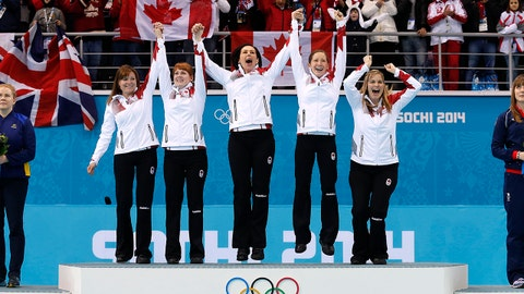 Canada's women's curling team as seen from left to right, Kirsten Wall, Dawn McEwen, Jill Officer, Kaitlyn Lawes and skip Jennifer Jones, celebrate during the flower ceremony after winning the women's curling gold medal game against Sweden at the 2014 Winter Olympics, Thursday, Feb. 20, 2014, in Sochi, Russia. (AP Photo/Wong Maye-E)