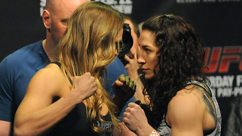 Feb 21, 2014; Las Vegas, NV, USA; Ronda Rousey (L) and Sara McMann (R) face off for photographs during the UFC 170 weigh-in at Mandalay Bay Events Center. Mandatory Credit: Stephen R. Sylvanie-USA TODAY Sports