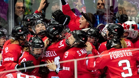 Team Switzerland celebrates their 4-3 win over Sweden in the women's ice hockey bronze medal game at Bolshoy Arena at the 2014 Winter Olympics, Thursday, Feb. 20, 2014, in Sochi, Russia. (AP Photo/J. David Ake)