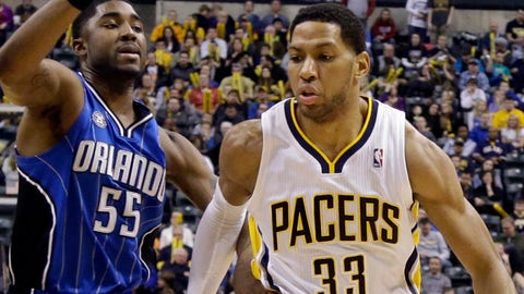 Indiana Pacers forward Danny Granger (33) drives in front of Orlando Magic guard E'Twaun Moore in the second half of an NBA basketball game in Indianapolis, Monday, Feb. 3, 2014. The Pacers defeated the Magic 98-79. (AP Photo/Michael Conroy)