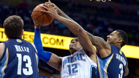 Orlando Magic forward Tobias Harris (12) goes up for a shot between Memphis Grizzlies forward Mike Miller (13) and forward James Johnson (3) during the second half of an NBA basketball game in Orlando, Fla., Wednesday, Feb. 12, 2014. The Grizzlies won 86-81. (AP Photo/Phelan M. Ebenhack)