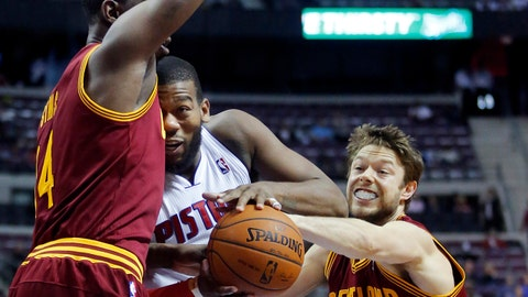 Cleveland Cavaliers guard Matthew Dellavedova (8) steals the ball as Detroit Pistons center Greg Monroe, center, collides with Cavaliers center Henry Sims, left, during the second half of an NBA basketball game Wednesday, Feb. 12, 2014, in Auburn Hills, Mich. The Cavaliers won 93-89. (AP Photo/Duane Burleson)