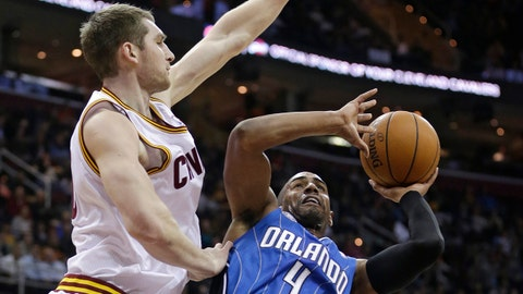 Orlando Magic's Arron Afflalo, right, shoots over Cleveland Cavaliers' Tyler Zeller during the first quarter of an NBA basketball game Wednesday, Feb. 19, 2014, in Cleveland. (AP Photo/Tony Dejak)