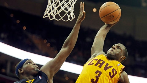 Cleveland Cavaliers' Dion Waiters (3) goes up for a dunk on Memphis Grizzlies' Zach Randolph in overtime of an NBA basketball game Sunday, Feb. 9, 2014, in Cleveland. Waiters scored 18 points in the Cavaliers 91-83 win. (AP Photo/Mark Duncan)