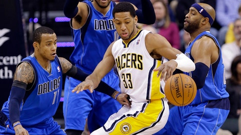 Indiana Pacers forward Danny Granger (33) loses control of the ball in front of, left to right, Dallas Mavericks guard Monta Ellis, forward Shawn Marion, and guard Vince Carter during the first half of an NBA basketball game in Indianapolis, Wednesday, Feb. 12, 2014. (AP Photo/Michael Conroy)