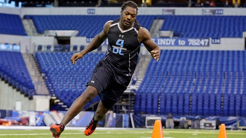 South Carolina defensive lineman Jadeveon Clowney runs a drill at the NFL football scouting combine in Indianapolis, Monday, Feb. 24, 2014. (AP Photo/Michael Conroy)