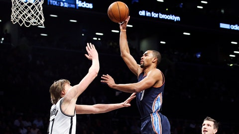 Charlotte Bobcats point guard Ramon Sessions (7) shoots over Brooklyn Nets forward Andrei Kirilenko (47) as center Andray Blatche (0), and forward Mirza Teletovic (33) stand near in the second half of an NBA basketball game Wednesday, Feb. 12, 2014, in New York. The Nets won 105-89. (AP Photo/John Minchillo)