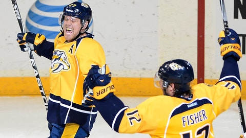 Nashville Predators forward Patric Hornqvist (27), of Sweden, celebrates with forward Mike Fisher (12) after Hornqvist scored the go ahead goal against the Tampa Bay Lightning in the third period of an NHL hockey game, Thursday, Feb. 27, 2014, in Nashville, Tenn. The Predators won 3-2. (AP Photo/Mark Zaleski)