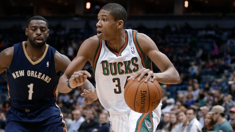 Milwaukee Bucks' Giannis Antetokounmpo drives against New Orleans Pelicans' Tyreke Evans (1) during the first half of an NBA basketball game Wednesday, Feb. 12, 2014, in Milwaukee. (AP Photo/Jeffrey Phelps)