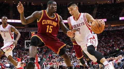 Feb 1, 2014; Houston, TX, USA; Houston Rockets point guard Jeremy Lin (7) drives the ball during the second quarter as Cleveland Cavaliers small forward Anthony Bennett (15) defends at Toyota Center. Mandatory Credit: Troy Taormina-USA TODAY Sports