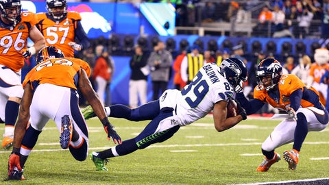 Feb 2, 2014; East Rutherford, NJ, USA; Seattle Seahawks wide receiver Doug Baldwin (89) dives in for a touchdown past Denver Broncos free safety Mike Adams (20) in the fourth quarter in Super Bowl XLVIII at MetLife Stadium.  Mandatory Credit: Mark J. Rebilas-USA TODAY Sports