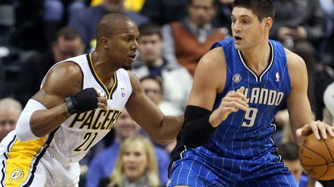 Feb 3, 2014; Indianapolis, IN, USA; Orlando Magic center Nikola Vucevic (9) is guarded by Indiana Pacers forward David West (21) at Bankers Life Fieldhouse. Indiana defeats Orlando 98-79. Mandatory Credit: Brian Spurlock-USA TODAY Sports
