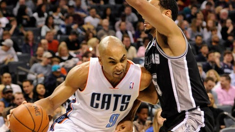 Feb 8, 2014; Charlotte, NC, USA; Charlotte Bobcats guard Gerald Henderson (9) moves past San Antonio Spurs guard Cory Joseph (5) during the first half of the game at Time Warner Cable Arena. Mandatory Credit: Sam Sharpe-USA TODAY Sports