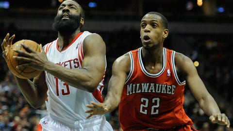 Feb 8, 2014; Milwaukee, WI, USA;  Houston Rockets guard James Harden (13) takes a shot against Milwaukee Bucks forward Khris Middleton (22) in the 2nd quarter at BMO Harris Bradley Center. Mandatory Credit: Benny Sieu-USA TODAY Sports