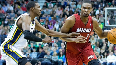 Feb 8, 2014; Salt Lake City, UT, USA; Utah Jazz small forward Jeremy Evans (40) defends against Miami Heat center Chris Bosh (1) during the first half at EnergySolutions Arena. Mandatory Credit: Russ Isabella-USA TODAY Sports