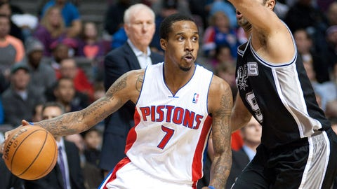 Feb 10, 2014; Auburn Hills, MI, USA; Detroit Pistons point guard Brandon Jennings (7) drives past San Antonio Spurs point guard Tony Parker (9) during the first quarter at The Palace of Auburn Hills. Mandatory Credit: Tim Fuller-USA TODAY Sports