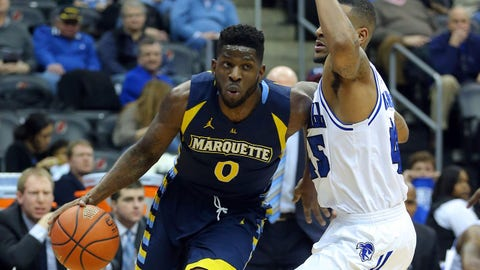 Feb 11, 2014; Newark, NJ, USA;  Marquette Golden Eagles forward Jamil Wilson (0) drives to the basket against Seton Hall Pirates forward Stephane Manga (45) during the first half at Prudential Center. Mandatory Credit: Jim O'Connor-USA TODAY Sports