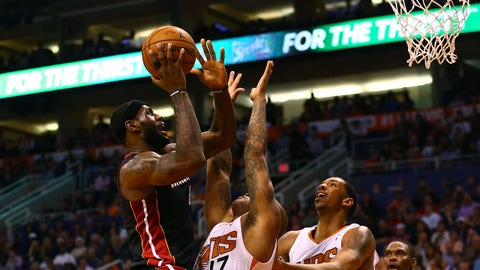 Feb 11, 2014; Phoenix, AZ, USA; Miami Heat forward LeBron James (6) against Phoenix Suns guard P.J. Tucker (17)  in the first half at the US Airways Center. Mandatory Credit: Mark J. Rebilas-USA TODAY Sports