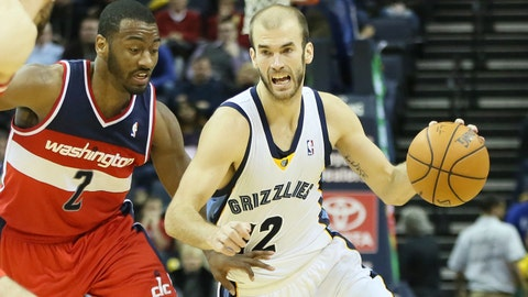 Feb 11, 2014; Memphis, TN, USA; Memphis Grizzlies guard Nick Calathes (12) dribbles the ball as Washington Wizards guard John Wall (2) chases at FedExForum. The Grizzlies won 92-89. Mandatory Credit: Nelson Chenault-USA TODAY Sports