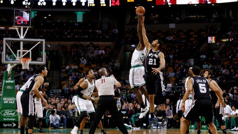 Feb 12, 2014; Boston, MA, USA; Boston Celtics forward/center Brandon Bass (30) and San Antonio Spurs forward/center Tim Duncan (21) battle for the tip off at the start of the first quarter at TD Garden. Mandatory Credit: Greg M. Cooper-USA TODAY Sports