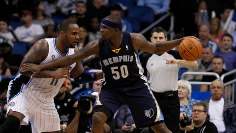 Feb 12, 2014; Orlando, FL, USA; Memphis Grizzlies power forward Zach Randolph (50) moves to the basket as Orlando Magic power forward Glen Davis (11) defends during the second half at Amway Center. Memphis Grizzlies defeated the Orlando Magic 86-81. Mandatory Credit: Kim Klement-USA TODAY Sports