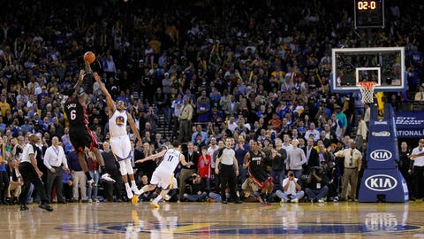 Feb 12, 2014; Oakland, CA, USA; Miami Heat forward LeBron James (6) shoots a three point shot over Golden State Warriors forward Andre Iguodala (9) with .2 seconds remaining at Oracle Arena. The Heat defeated the Warriors 111-110. Mandatory Credit: Cary Edmondson-USA TODAY Sports