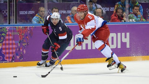 Feb 15, 2014; Sochi, RUSSIA; Russia forward Alex Ovechkin (8) skates past USA forward Zach Parise (9)in a men's preliminary round ice hockey game during the Sochi 2014 Olympic Winter Games at Bolshoy Ice Dome. Mandatory Credit: Jayne Kamin-Oncea-USA TODAY Sports
