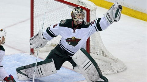 Feb 6, 2014; Saint Paul, MN, USA; Minnesota Wild goalie Darcy Kuemper (35) against the Nashville Predators at Xcel Energy Center. The Wild defeated the Predators 3-2 in overtime. Mandatory Credit: Brace Hemmelgarn-USA TODAY Sports