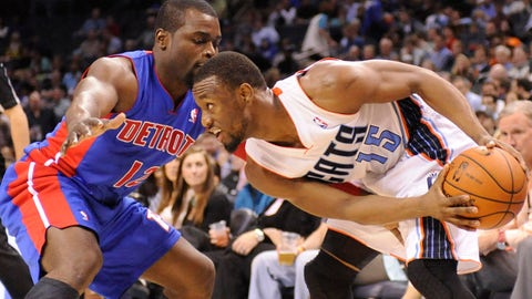 Feb 19, 2014; Charlotte, NC, USA; Charlotte Bobcats guard Kemba Walker (15) controls the ball as he is defended by Detroit Pistons guard Will Bynum (12) during the second half of the game at Time Warner Cable Arena. Bobcats win 116-98. Mandatory Credit: Sam Sharpe-USA TODAY Sports