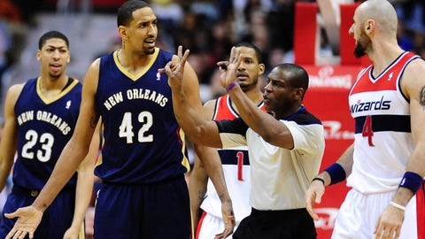 Feb 22, 2014; Washington, DC, USA; New Orleans Pelicans center Alexis Ajinca (42) reacts after being called for a technical foul in the fourth quarter against the Washington Wizards at Verizon Center. Mandatory Credit: Evan Habeeb-USA TODAY Sports