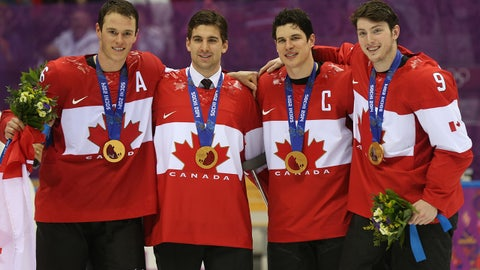 Feb 23, 2014; Sochi, RUSSIA; Canada forward Jonathan Toews (16), Canada forward Jon Tavares (20), Canada forward Sidney Crosby (87), and Canada forward Matt Duchene (9) celebrate winning the gold medal against Sweden in the men's ice hockey gold medal game during the Sochi 2014 Olympic Winter Games at Bolshoy Ice Dome. Mandatory Credit: Winslow Townson-USA TODAY Sports