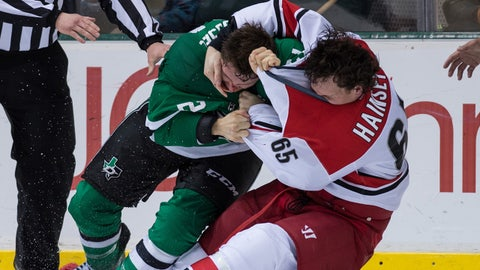 Feb 27, 2014; Dallas, TX, USA; Dallas Stars left wing Antoine Roussel (21) fights with Carolina Hurricanes defenseman Ron Hainsey (65) during the third period at the American Airlines Center. The Stars won 4-1. Mandatory Credit: Jerome Miron-USA TODAY Sports