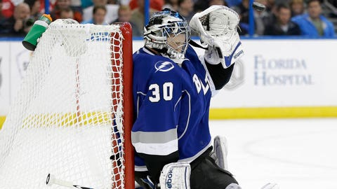 Tampa Bay Lightning goalie Ben Bishop (30) covers up as he prepares to make a glove save on a shot by the Detroit Red Wings during the first period of an NHL hockey game Saturday, Feb. 8, 2014, in Tampa, Fla. (AP Photo/Chris O'Meara)