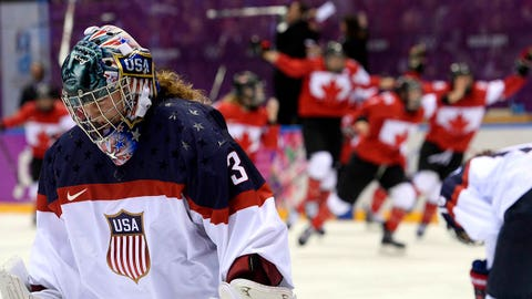 US goalkeeper Jessie Vetter reacts at the end of the Women's Ice Hockey Gold Medal Game between Canada and USA at the Bolshoy Ice Dome during the Sochi Winter Olympics on February 20, 2014.     AFP PHOTO / JONATHAN NACKSTRAND        (Photo credit should read JONATHAN NACKSTRAND/AFP/Getty Images)