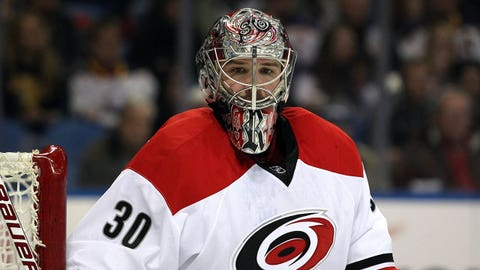 Feb 25, 2014; Buffalo, NY, USA; Carolina Hurricanes goalie Cam Ward (30) looks for the puck during the second period against the Buffalo Sabres at First Niagara Center. Mandatory Credit: Timothy T. Ludwig-USA TODAY Sports