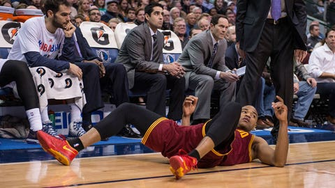 Feb 3, 2014; Dallas, TX, USA; Cleveland Cavaliers shooting guard C.J. Miles (0) falls to the court after being fouled during the second half against the Dallas Mavericks at the American Airlines Center. The Mavericks defeated the Cavaliers 124-107.  Mandatory Credit: Jerome Miron-USA TODAY Sports