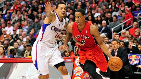February 7, 2014; Los Angeles, CA, USA; Toronto Raptors shooting guard DeMar DeRozan (10) moves the ball against Los Angeles Clippers small forward Matt Barnes (22) during the first half at Staples Center. Mandatory Credit: Gary A. Vasquez-USA TODAY Sports