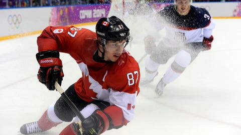 Canada's Sidney Crosby (87) vies for the puck against US Cam Fowler (3) during the Men's Ice Hockey Semifinals USA vs Canada at the Bolshoy Ice Dome during the Sochi Winter Olympics on February 21, 2014.   AFP PHOTO / JONATHAN NACKSTRAND        (Photo credit should read JONATHAN NACKSTRAND/AFP/Getty Images)