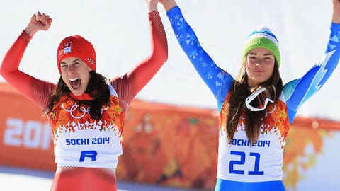 SOCHI, RUSSIA - FEBRUARY 12:  Gold medalists Dominique Gisin of Switzerland (L) and Tina Maze of Slovenia celebrateon the podium during the flower ceremony for during the Alpine Skiing Women's Downhill on day 5 of the Sochi 2014 Winter Olympics at Rosa Khutor Alpine Center on February 12, 2014 in Sochi, Russia.  (Photo by Richard Heathcote/Getty Images)