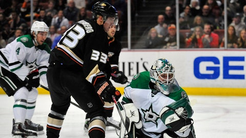 February 1, 2014; Anaheim, CA, USA; Dallas Stars goalie Dan Ellis (30) blocks a shot against Anaheim Ducks left wing Jakob Silfverberg (33) during the second period at Honda Center. Mandatory Credit: Gary A. Vasquez-USA TODAY Sports