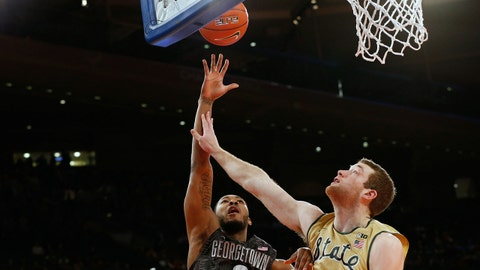 Feb 1, 2014; New York, NY, USA;  Georgetown Hoyas forward Mikael Hopkins (3) shoots over Michigan State Spartans forward Matt Costello (10) during the first half at Madison Square Garden. Mandatory Credit: Anthony Gruppuso-USA TODAY Sports