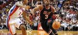 D-Wade helps Heat top Pistons