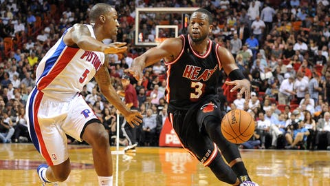 Feb 3, 2014; Miami, FL, USA; Miami Heat shooting guard Dwyane Wade (3) drives to the basket as Detroit Pistons shooting guard Kentavious Caldwell-Pope (5) defends during the second half at American Airlines Arena. Mandatory Credit: Steve Mitchell-USA TODAY Sports
